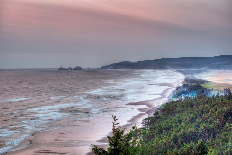 7-7-12 Pastel Sunset from Cape Lookout Across to Three Arches,  Cape Lookout, Oregon Coast<br /> <br /> Last night was beautiful...little wind...red ball of fire and pastel colors across the landscape.  We traveled down to Newport and got to see four whale blows, photographed the murre colony at Yaquina Head, an oystercatcher, the Newport Bridge, Yaquina Head Lighthouse, and a few other things.  There was a nest of peregrine falcons at the Interpretive Center but they just fledged so we were treated to an aerial display put on by three of the babies.  Another glorious day at the coast.  Not sure what lies in store yet for today.
