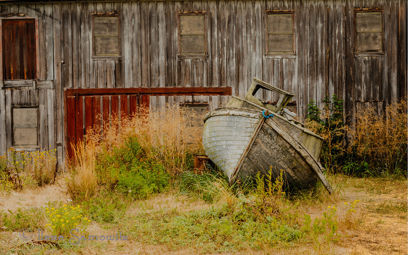 "8-27-12 Shipwrecked in Semiahmoo.  This view of the shipwrecked boat is very artistic but does not give the correct impression of scale.  The boat is considerably taller than I (5'5"") and it is up against a decaying building.  Semiahmoo Spit is a very enjoyable destination for a long day trip from Seattle.  The views are spectacular and there are plenty of photography opportunities including shots of Mount Baker, birds, the marina, and the old buildings and shipwrecked boat at the end of the spit.  <br /> <br /> This is a 5 shot HDR processed with Photomatix starting with the photographic preset and customizing the settings and lightroom developing to taste.  <br /> <br /> Critiques welcome."