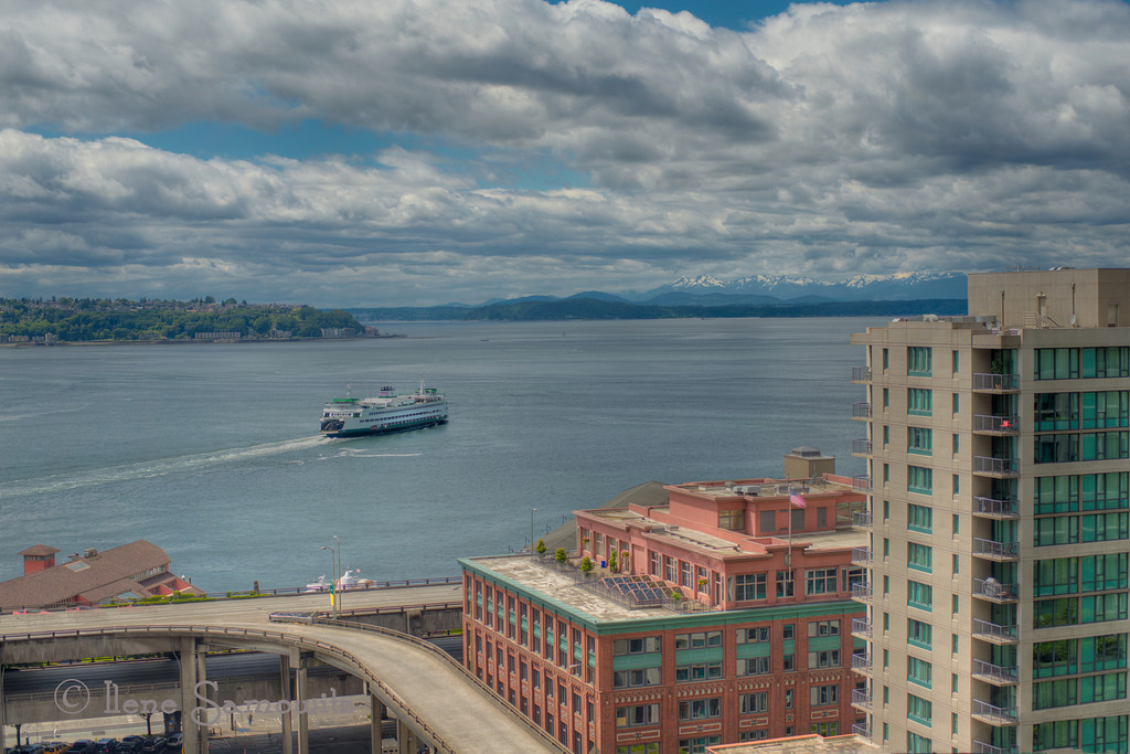 View From Downtown Seattle - 6/7/12 - This was taken from the eighth floor patio of the office building that I work in.  Looking towards the Seatte waterfront and the ferry.  In the distance you can see the tops of the Olympic Mountains.