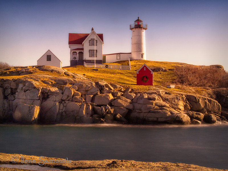 12-19-12 Nubble lighthouse in Color.  I want to ask your opinion on whether you like this better in color or black and white (yesterday's)<br /> <br /> Thanks for all the feedback and support of my work.