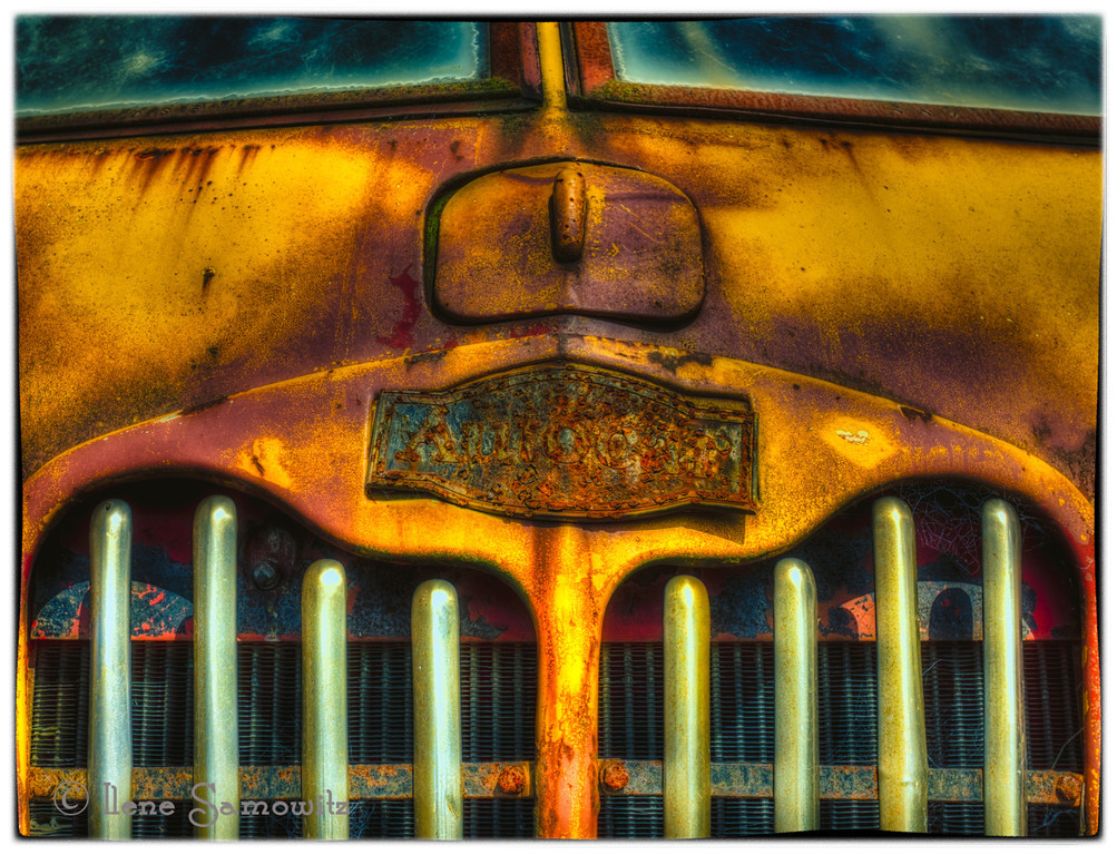 "9-6-13 Details on an old vehicle found at the Great Blue Heron Cheese Factory in Tillamook, Oregon.  Does anyone know what vehicle this is?<br /> <br /> I agree with Terry (thank you)  that I saw something that looked like Autocar as well.  I had never heard of them so I didn't investigate.  In reading about them in Wikipedia that makes sense especially since I took pictures of White vehicles as well which I also never heard of.  <br /> <a href=""http://en.wikipedia.org/wiki/Autocar_Company"">http://en.wikipedia.org/wiki/Autocar_Company</a>"