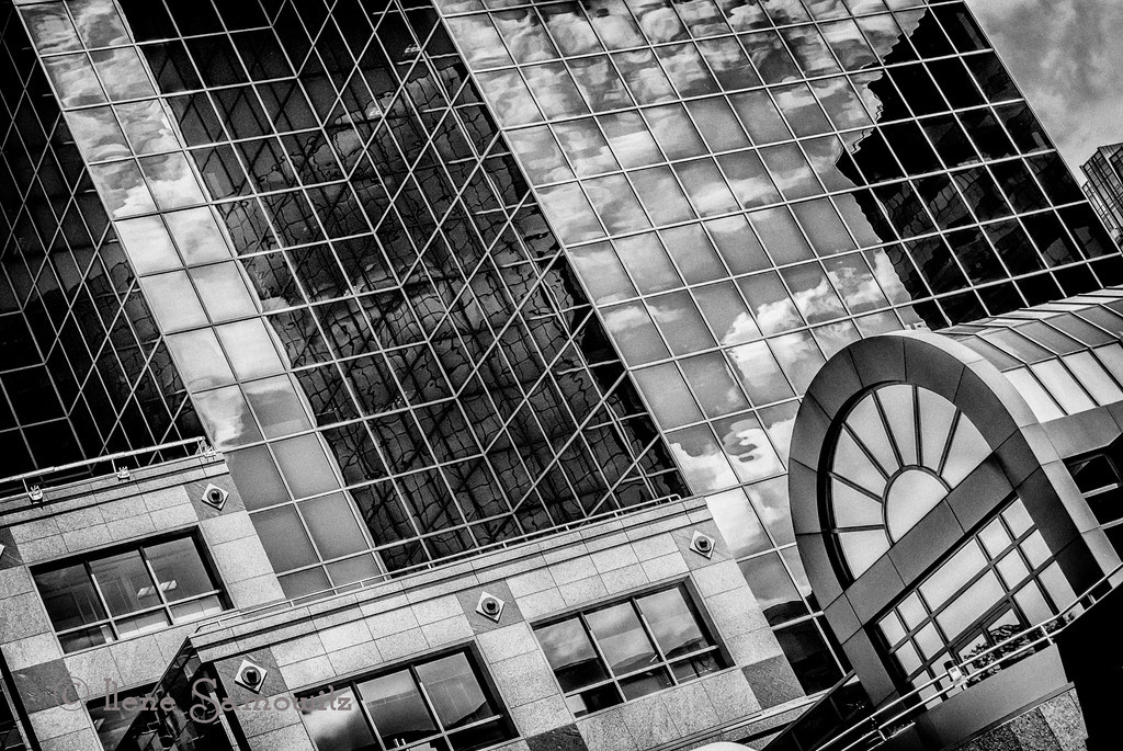 5-30-13 This is another in my series of building reflections in downtown Bellevue.  I converted using Silver Effex Pro 2 and used the new Clarity from Topaz.