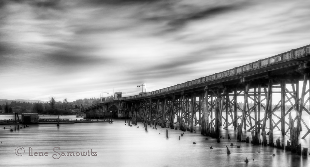 1-3-13 Young's Bay Bridge #2 -this was a 40 second long exposure done during the afternoon with a 10 stop Big Stopper ND filter.  I tone-mapped this single image exposure using Photomatix Pro and converted to Black and White using Silver Effex 2.<br /> <br /> Critiques Welcome.