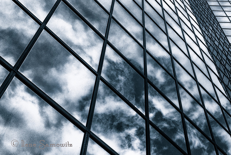 4-18-13 Sky Reflections on the building where I started working on Monday.  This is in Bellevue, Washington.  I converted this image in Silver Effex Pro 2 and toned with cyanotype.