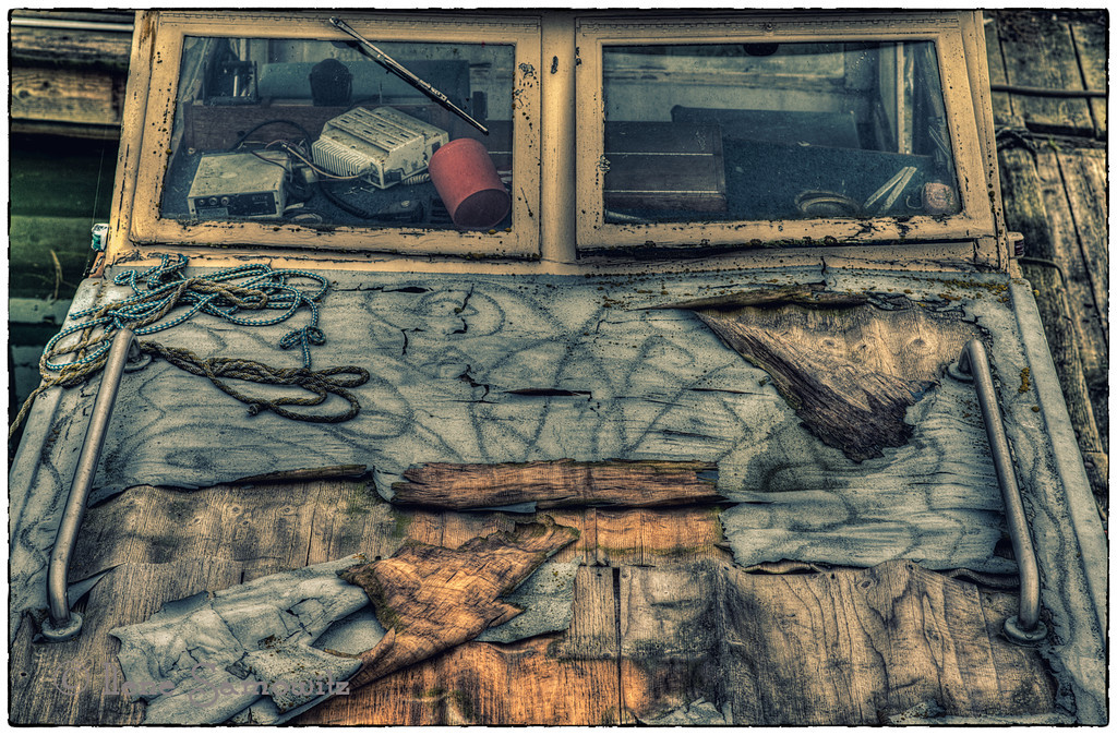 9-17-13 This is a decaying boat. It seems that I am attracted to decaying objects. This is a 5 shot HDR taken with my Nikon D800e and the super sharp 85 f1.8 (according to DxO the sharpest 85 on the market). Sweet Bokeh as well (not quite as nice as the 1.4 but about 35% of the cost). <br /> <br /> I also used Color Effex Pro 4 using the cross processing filter.