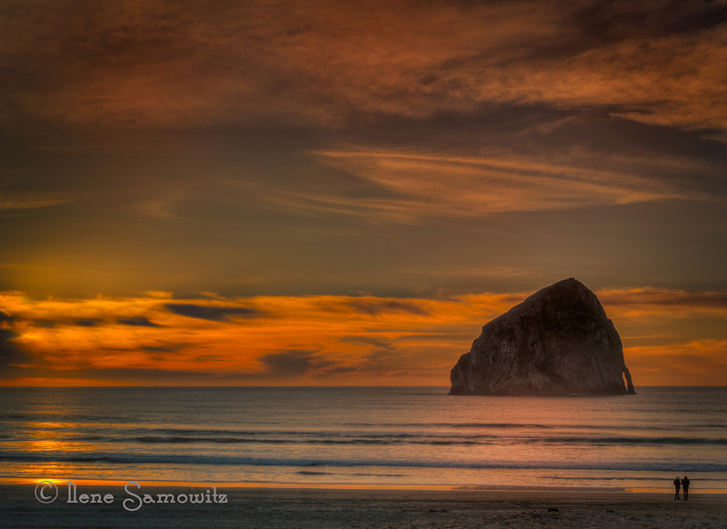 12-31-13 Beautiful sunset at Pacific City, Oregon looking at Haystack Rock.<br /> <br /> Happy New Year to all<br /> <br /> I appreciate this community that I have been part of for the last two years. This is the beginning of my third year. I appreciate the support and inspiration as well as the sharing.