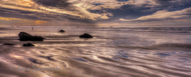 1-1-14 This is Ona Beach, Oregon. I had heard about this part of the beach with rocks that look like moonstones. <br /> <br /> Thanks for making my image of Haystack Rock number one. It is truly an honor!