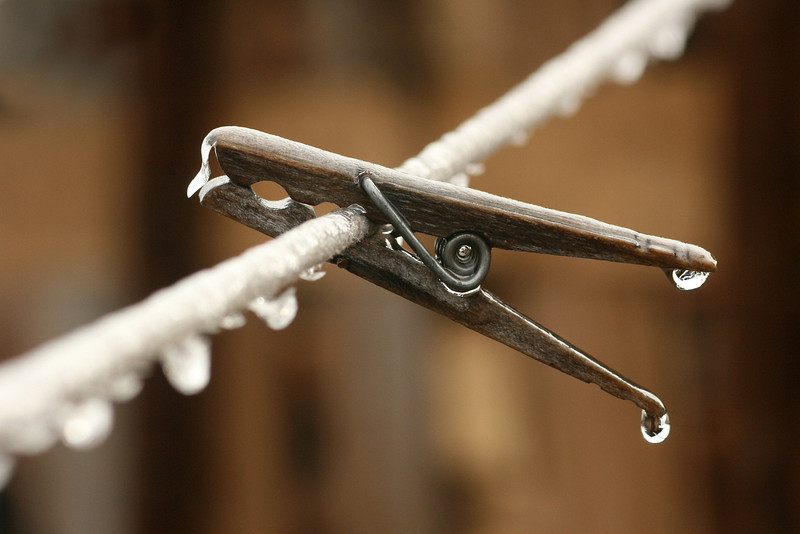 Clothes pin frozen on the line by Sue Anderson.