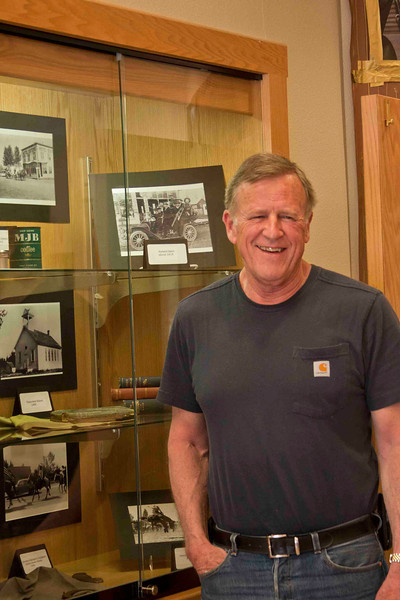 Sisters Mayor Lon Kellstrom happened to stop in the Sisters Library and was surprised by a historical photo exhibit on display. His town has changed just a bit.