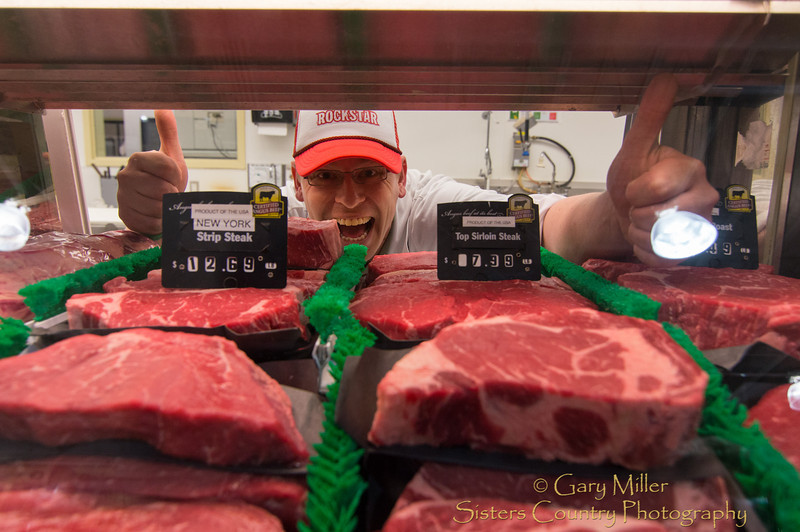 A man that loves his work and people, Casey Moore delights in spreading smiles around the world. Casey practices this art to perfection in the meat and fish department of Ray's Market in Sisters, Oregon.