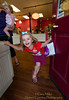 """I love shopping in Sisters, Oregon!""  A young shopper shows her exuberance after enjoying a sweet yogurt treat at ' Cuppa Yo' in Sisters, Oregon. May 15, 2012 for the ADay.org project by Gary N. Miller - Sisters Country Photography"