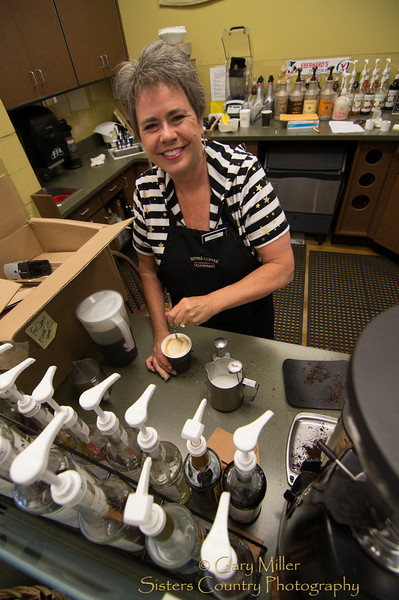 Debbie Bucher knows how to make a great latte at the Sisters Coffee outlet in Ray's Market in Sisters, Oregon -  Gary N. Miller - Sisters Country Photography