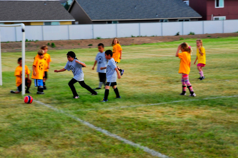 1831, The reason for Soccer Moms as their kids play soccer(Futball) in the evening. Madras, Oregon - Bill Volmer