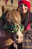 Her First Christmas - A 4 month old filly looking just a tad nervous at the Sisters Christmas Parade - Sisters, OR 2009. Gary Miller - Sisters Country Photography