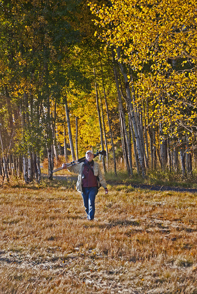 Gary Miller walking back from a photo shoot in the Aspens at Black Butte Ranch.  10/16/11 Kate Thomas Keown