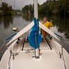 Beckie Zimmerman greets the world from the deck of the White Rabbit while anchored in a slough near Cathlamet, WA - Photo by Gary Miller - Sisters Country Photography