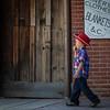 Lolly pop toting buckaroo patrols the streets.  g.waddell
