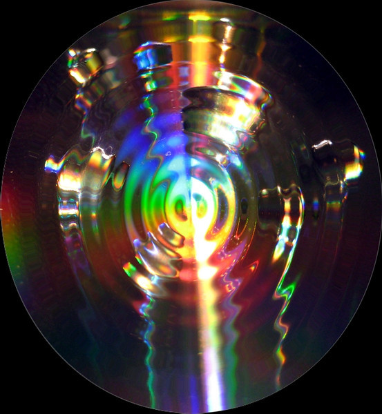 Fun Photo Art! Created with a CD disk, water, and direct light.