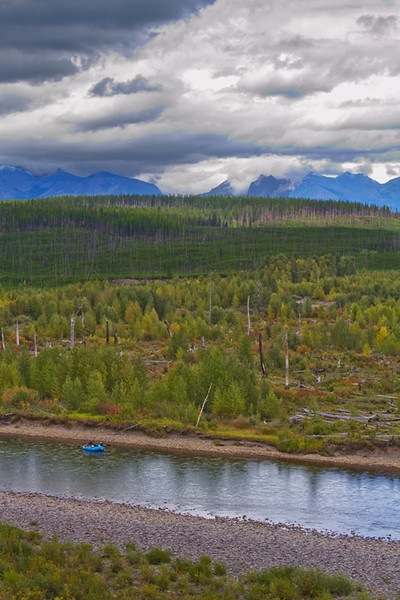 As I watched this tiny raft floating down the North Fork of the Flathead River and looked to the mountains beyond, it was easy to feel how small and insignificant we are on this beautiful planet.  September, 2016.