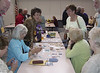 As a part of our 50th class reunion some of us created and exchanged Artist's Trading Cards. Around the table, from left: Elaine, Mary, M, MJ, Carol and Jeanette. The husbands looking on are Tony and Bob.  May, 2008.