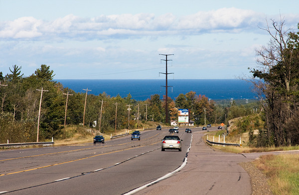 This view of Lake Superior as I'd come over the hill from the west always amazed me--the high horizon with Marquette down where the distant utility poles are seen. It defies logic. September, 2010.