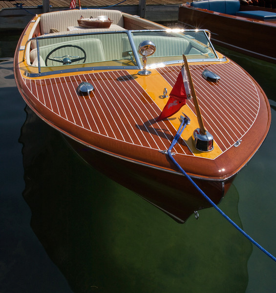I returned to the U.P. of Michigan in time to attend the Antique Wood Boat Show at Hessel. The craftsmanship of the restorers is AMAZING! I'm guessing this Chris Craft is from around 1950, give or take 10 years, Several owners also displayed a model of the boat with it. August, 2010.