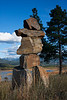 These balanced rocks are called inuksuks.  Originally, they were made by Aboriginals using one or more rocks in a place to show travel routes, camps, fishing spots, places of inspiration, food caches, or the like; they are still used in this way above the Arctic Circle.  In modern times they have become symbols of hospitality, friendship, and safe travels. This one overlooking the Canal Flats in BC may have been created by an artist as it is similar to the one given to the USA that is in Washington, DC. (The bump on the right side of the middle rock is level with the top of my head.) September, 2011.