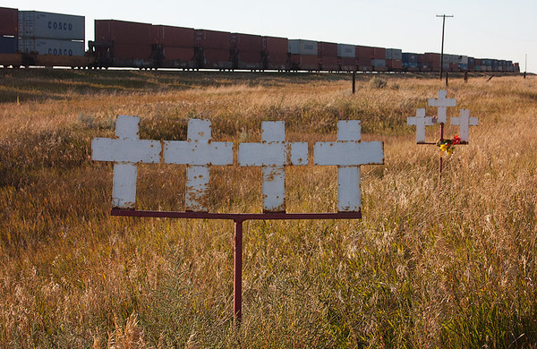 Montana places these markers where highway fatalities occur.  Running parallel to the train track is a highway on the right. September, 2012.