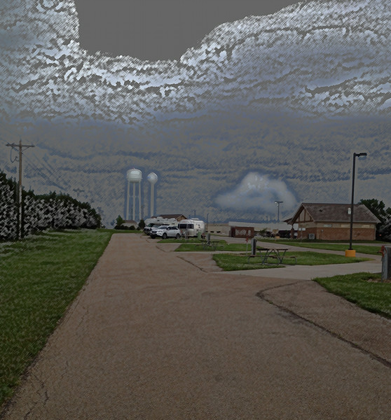 """Simulated """"buttermilk sky"""" as I encountered more thunderstorms, this time at the Prairie Band Casino RV Park north of Topeka. After spending all winter with hardly a trace of rain or storms this seemed like overkill in KS and NE.  Here I thought the wind would roll my little Cloud like a tumbleweed, but it stayed on two wheels.  The power was off for over 2 hours, however.  June, 2014."""