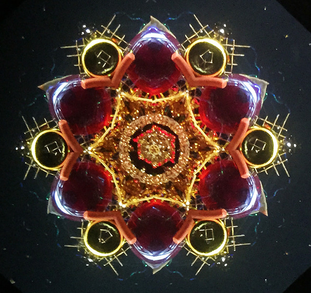 One of the galleries (The Purple Pomegranate) at the Whitefish Art Walk offered a kaleidoscope for my collection.  I couldn't resist.  July, 2015.