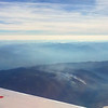 Forest fires seen from above as I flew out of Kalispell.  I think I heard that a quarter of Montana was on fire at one point,  Flathead Lake is seen in the lower right.  The following 5 images are in chronological order.  August, 2017.