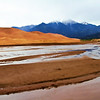 Another visit to Great Sand Dunes NP.  Being spring the creek was running full and there were snow and clouds on the mountains.  June, 2017.