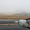 Leaving the smoke behind, I headed into a Winter Weather Advisory two days later just south of Helena.  I checked radar maps and highway elevations and figured this stretch would be the riskiest.  This hill disappeared into the clouds with the snow deeper at the top.  Even though it was snowing, (note snow on roof tops) it was melting at the lower elevation where the road ran.  I hit more snow later on I-90.  Only a little stressful!  September, 2017.