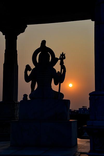 Deity Vishnu at sunset