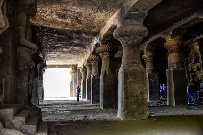 One of the Elephanta caves showing statues and pillars carved out of the mountain