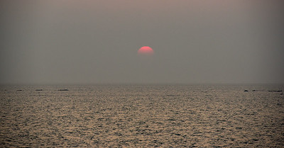 last sun as it dips behind the pollution