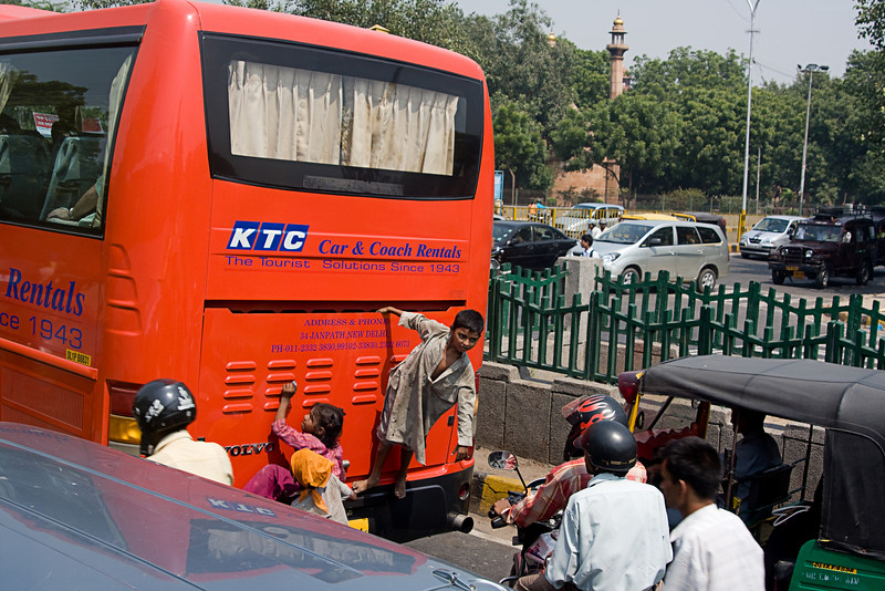 <center>Kids Hitching a Ride <br>Delhi, India </center>