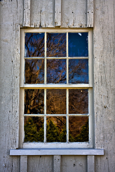 <center>April 16, 2009<br><br>Textured Reflections<br><br>Here's an interesting shot of some trees and bushes reflected in the window of an 18th century blacksmith shop on historic Great Road in Lincoln.  The blacksmith shop is still in use as a cultural center depicting life in the 18th century.<br><br>Blacksmith<br>Lincoln, Rhode Island</center>