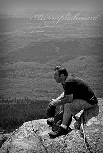 Accomplishment  On one of the day hikes with my good friend Andrew, we took a break after summitting Grand Monadnock. The effort was rewarded with stunning vistas and a refreshing breeze.