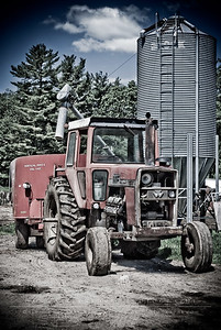 Another view of the tractor parked under the hopper.
