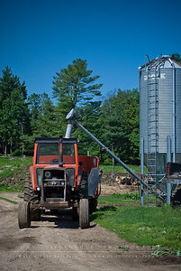 A view of the tractor parked under the hopper.