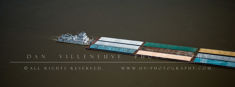 This boat is pushing several tethered barges down the Mississippi River as seen from atop the St. Louis Arch.