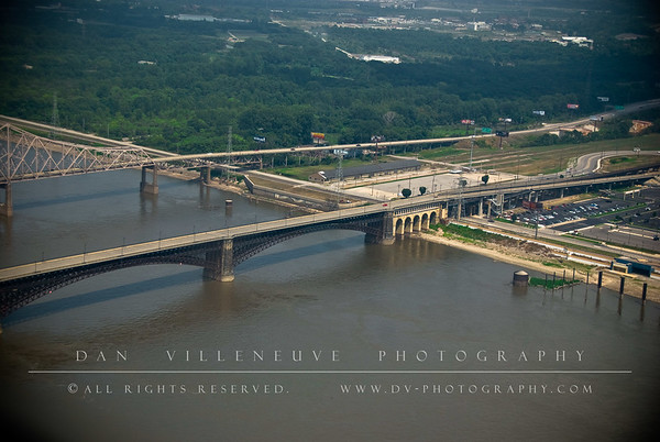 A view of the Martin Luther King Bridge (top) and the Eads Bridge (center) from atop the St. Louis Arch.