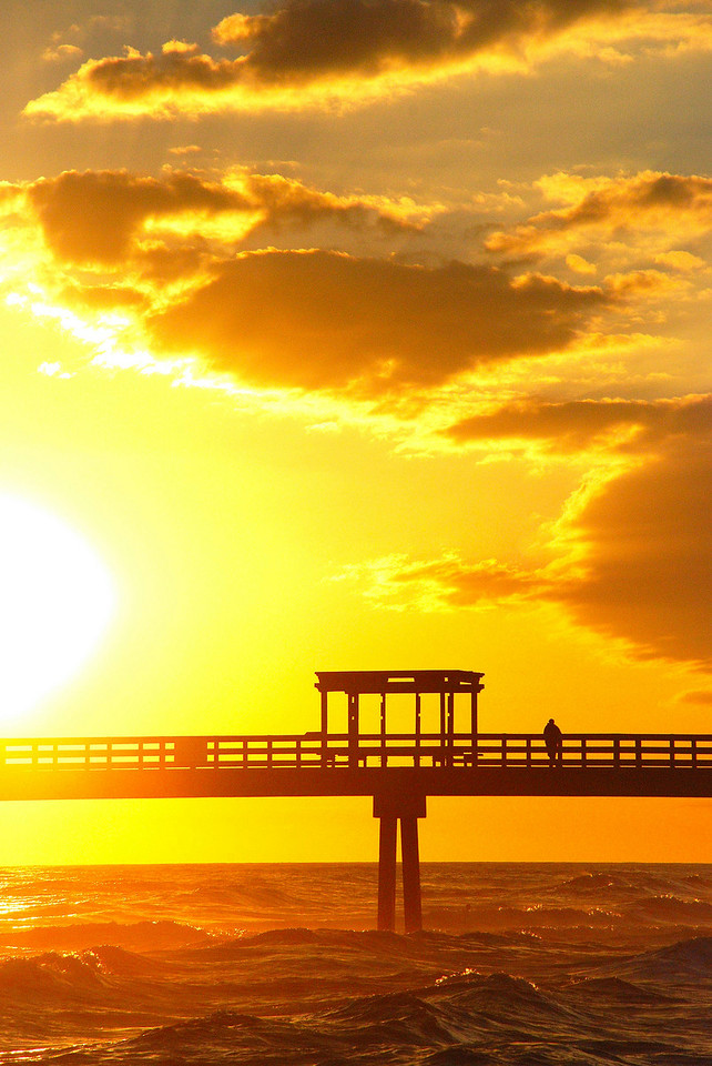 Navarre Beach: Take a moment off the trail and soak up the last of the days rays<br /> PHOTO by Kristen Johns