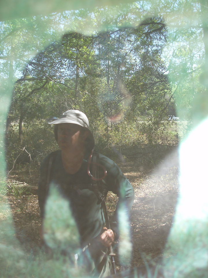 Single exposure photo capturing the reflection of hiker Paul Guyon as he was looking at a kiosk along the Florida Trail<br /> PHOTO by Robert Coveney