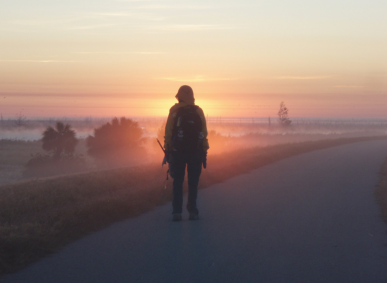 "BEST OF SHOW<br /> Hiker at sunrise on the Big ""O"" November 2008<br /> Photo by Jack Hailman"