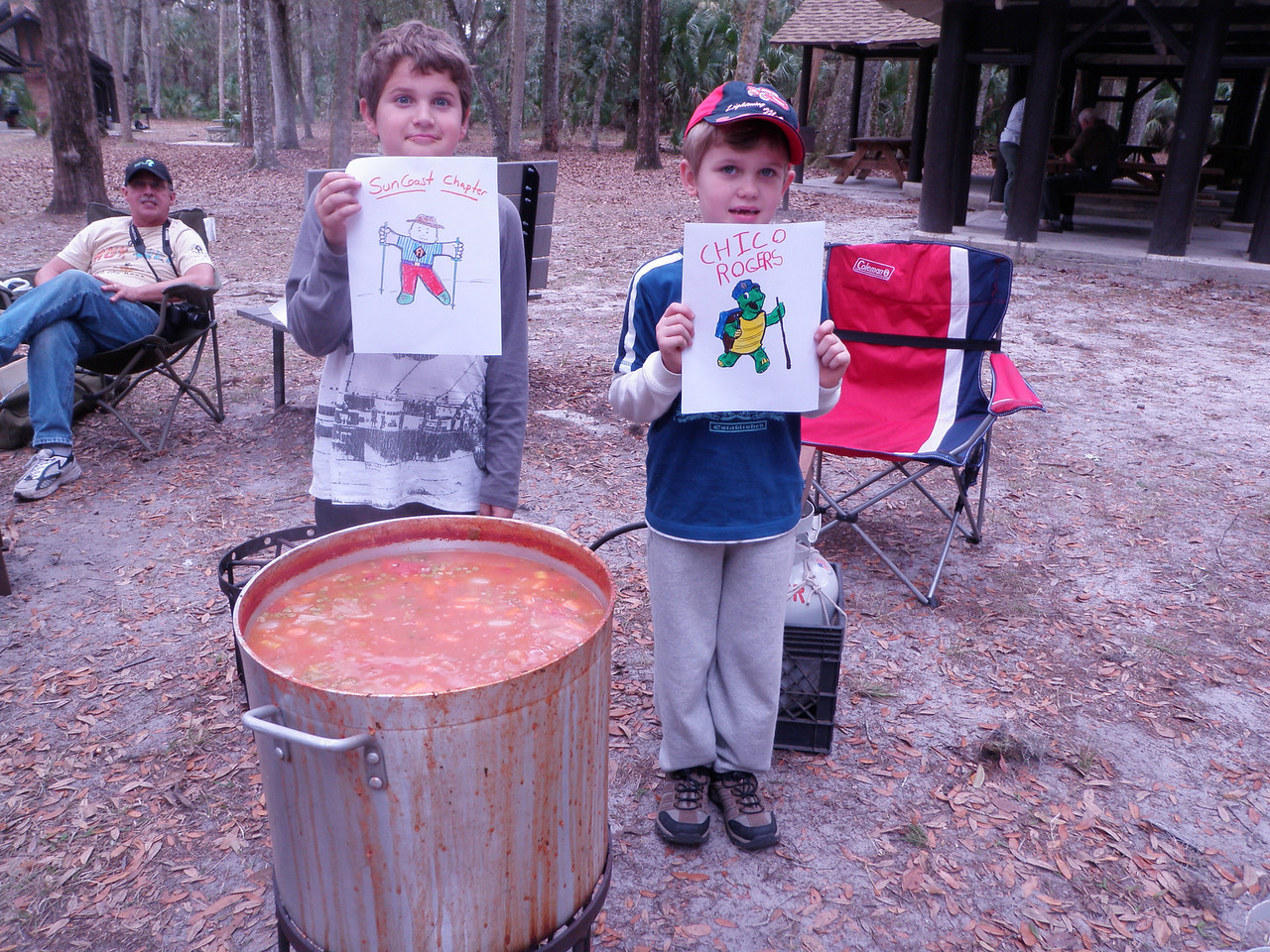 Ben & Marcus with their new friends stirring stone soup, Suncoast chapter meeting<br /> Photo by Tom Hammond