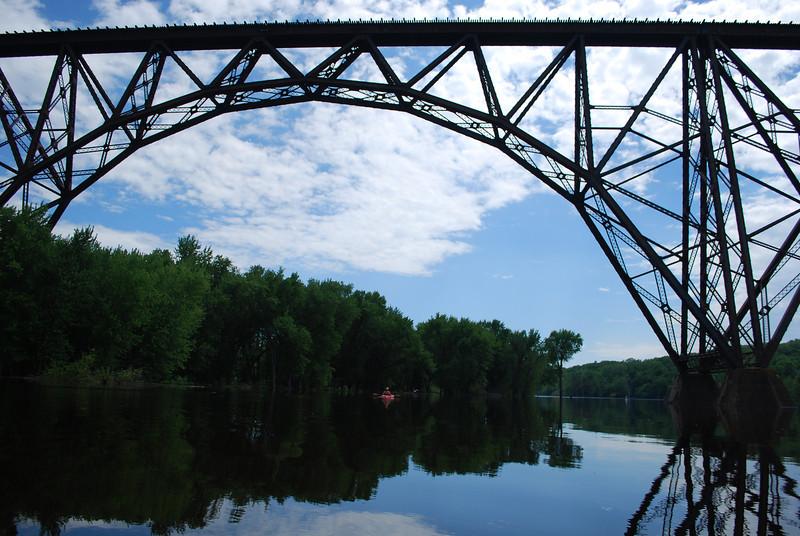 Railroad bridge and paddler