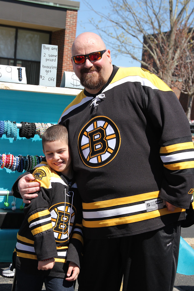 Peabody Mass.  April 23 2017;  touch a truck. Lynnfield residents Alex (6) and Michael Amico look through the bracelets while waiting for a hockey game. BOB ROCHE