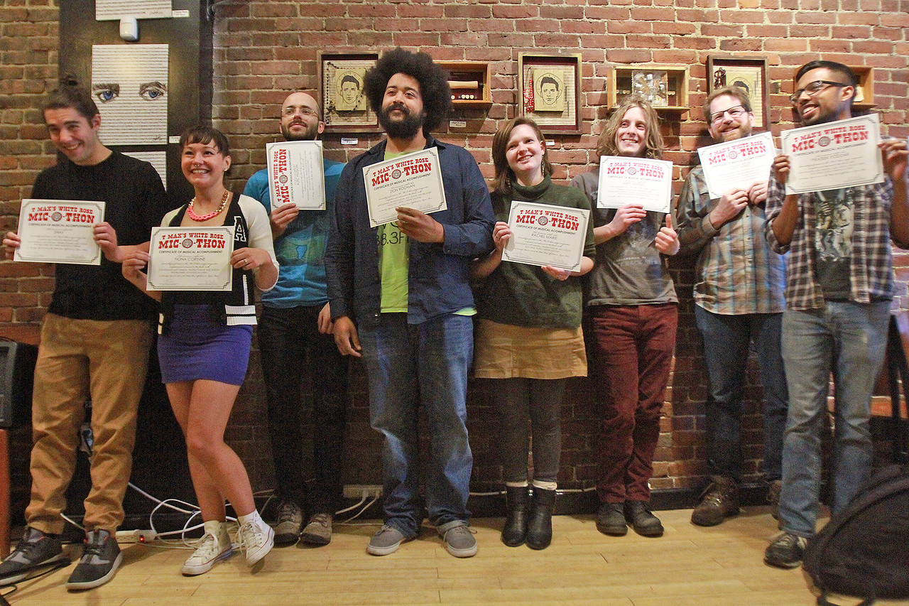 Finals pose with their certificates before the winner is announced at T-Max's Mic-O-Thon solo singer-songwriter competition Sunday, April 23, at the White Rose Coffeehouse. [Photo / Nicole Goodhue Boyd]